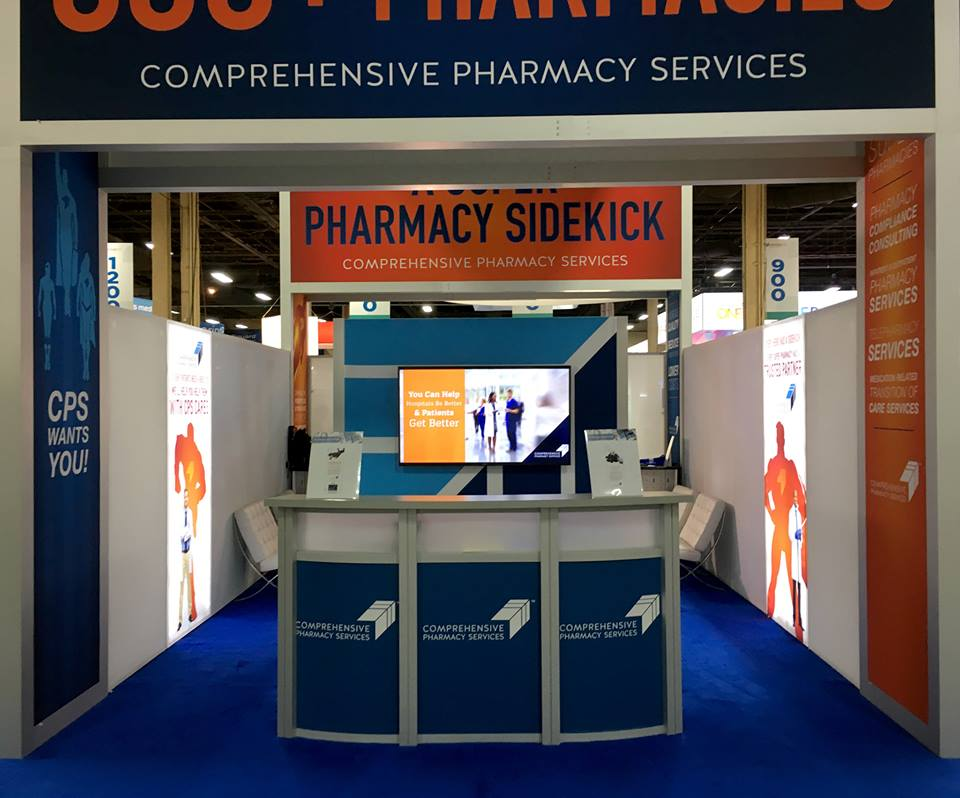 comprehensive pharmacy services trade show island backlit graphics reception counter